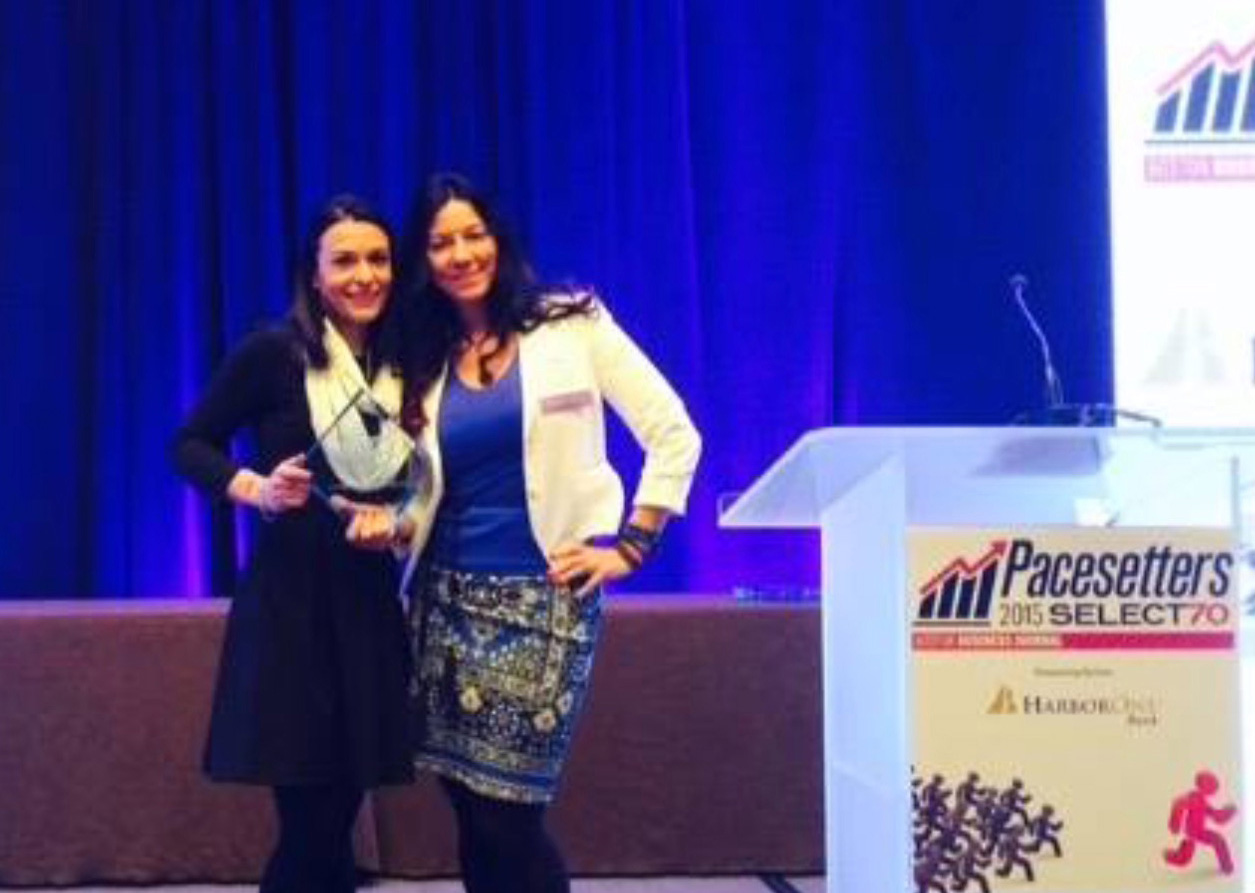 Imajine That's Vice President of Operations Jessica Brenes and Susan  receive the Boston Business Journal Pacesetters Award for the Fastest-Growing Companies in Boston in 2015.