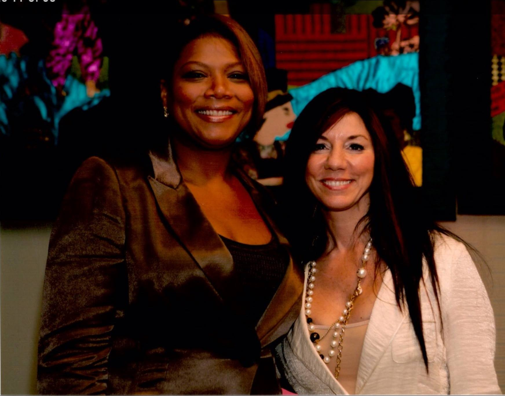 Susan is honored by Queen Latifah with the Boston Women's Fund Women of Action Award.