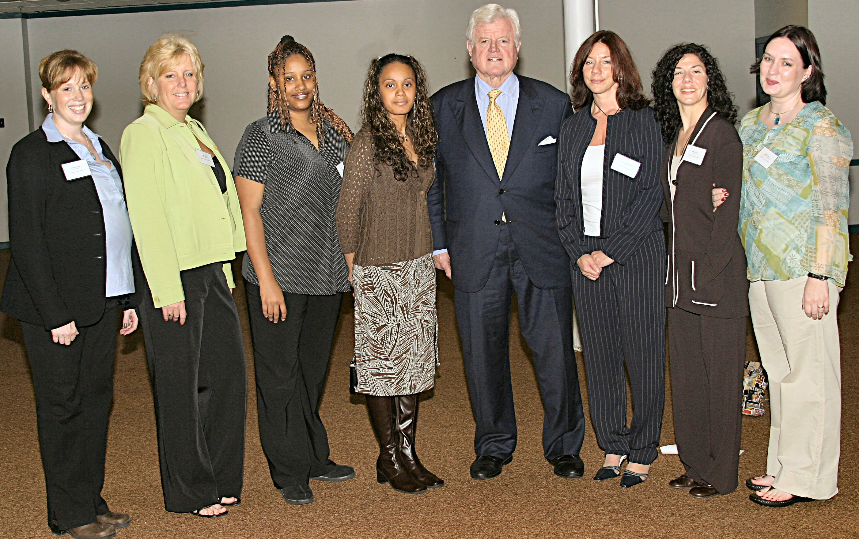 Senator Ted Kennedy celebrates with Susan and her team at the Inspirational Ones - Project Strive graduation ceremony.