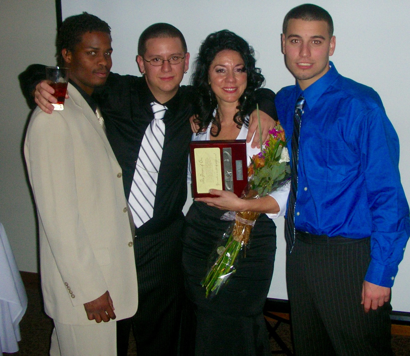 Susan at Sprouts 25th Anniversary receiving The Power of One Award with sons Marvin Neal, Nicholas Ferraro and Anthony Ferraro.