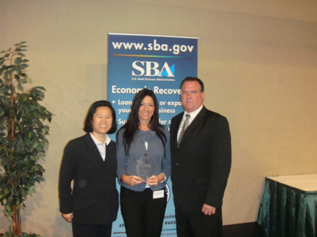 Susan receiving the U.S. Small Business Administration's Massachusetts Women in Business Champion Award