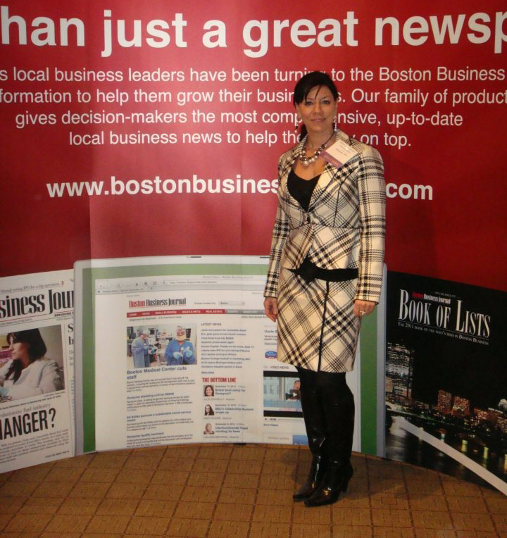 Susan accepts Top 100 Women-Led Businesses in Massachusetts Award.